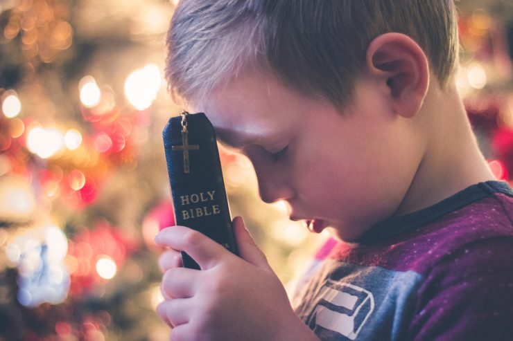 Child bible praying
